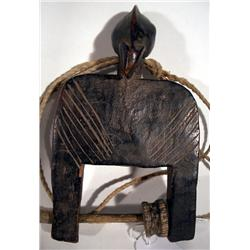 A FINE AND EARLY SENUFO HEDDLE PULLEY,of wood in