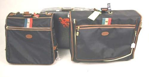A BLACK SUITCASE AND MATCHING VALET BAG Labeled Lark, together ...