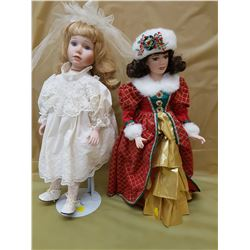 TWO DOLLS ON STANDS