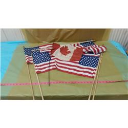 FIVE AMERICAN FLAGS AND ONE CANADIAN FLAG