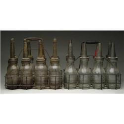 TWO SETS OF OIL BOTTLES IN WIRE CARRIERS