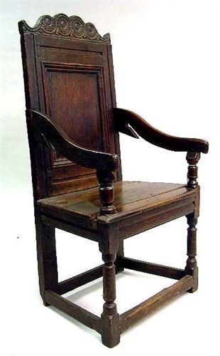 A CHARLES II CARVED OAK WAINSCOT CHAIR. Loading Zoom