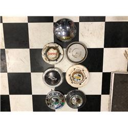 NO RESERVE COLLECTION OF 7 VINTAGE HUB CAPS SELLING AS ONE LOT