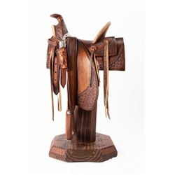 William M. Churchill Jr., hand-carved wooden saddle