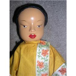 Chinese doll with painted features #859514