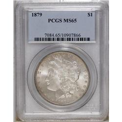 1879 S$1 MS65 PCGS. Lustrous silver-gray surfaces reve