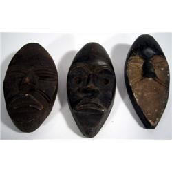 THREE DAN MINIATURE PASSPORT MASKS