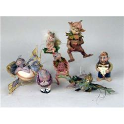 A GROUP OF SEVEN POLYCHROME DECORATED COMPOSITION FIGURES