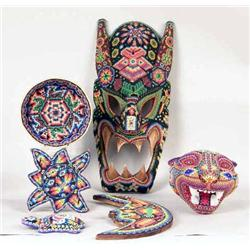 A CARVED WOOD BEAD DECORATED TABLE ARTICLES