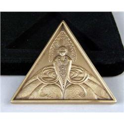 A BRONZE TRIANGULAR MEDALLION