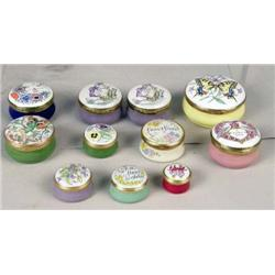 A GROUP OF HAND PAINTED METAL MOUNTED HINGED PORCELAIN CIRCULAR BOXES