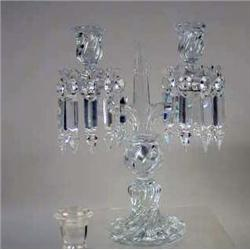 A COLORLESS GLASS TWO-ARM CANDLESTICK