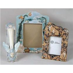 TWO POLYCHROME-DECORATED PARCEL-GILT CERAMIC PICTURE FRAMES