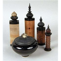 A GROUP OF FOUR CARVED WOOD PERFUME BOTTLES