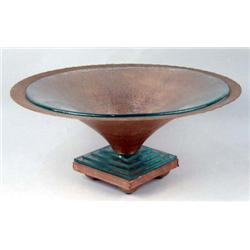 A FOOTED COPPER COMPOTE