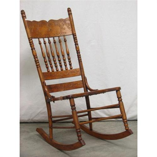 - Oak Carved Spindle Cane-seat Rocking Chair
