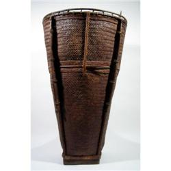 A SUPERB DAYAK BASKET,