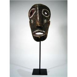 AN OLD DAYAK CEREMONIAL MASK,