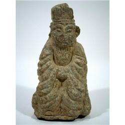 A MING DYNASTY GREEN SCHIST SCULPTURE,