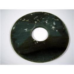 A FINE CHINESE NEOLITHIC JADE PI DISC,