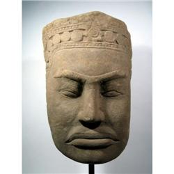 A FINE AND MONUMENTAL KHMER SANDSTONE HEAD,