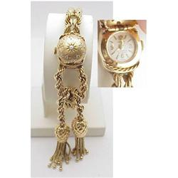 Vintage covered face 14kt gold watch