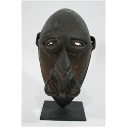 A RARE SCHOETEN ISLAND ANCESTOR MASK