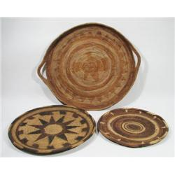 THREE WOVEN CANE BUKA ISLAND TRAYS