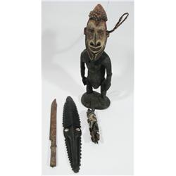 A COLLECTION OF FOUR MELANESIAN ARTEFACTS