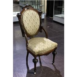 Victorian period parlor chair with unique open back and turned legs upon castored feet.