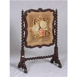 Mahogany fireplace screen with carved barley twist supports and needlepoint face. 42'' x 26''