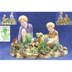 A Boy And Girl In A Garden Of Flowers  #2394606