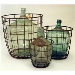 ANTIQUE WINE BOTTLE IN WIRE BASKET - SMALL #2377280