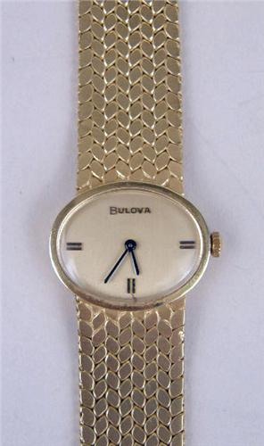 A Christian Dior Collection By Bulova 14k Yellow Gold