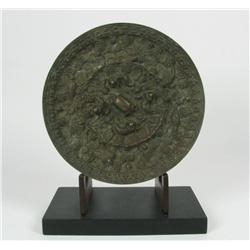 A SUPERB TANG DYNASTY BRONZE MIRROR, c.618-90