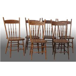 Lot of 6: Oak Pressed Back Spindle Chairs.