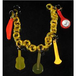 Bakelite Bracelet with Instruments.