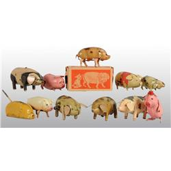 Lot of 11: Tin Pig Wind-Up Toys.