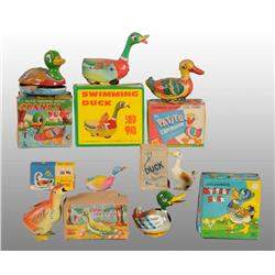 Lot of 11: Tin Duck Toys.