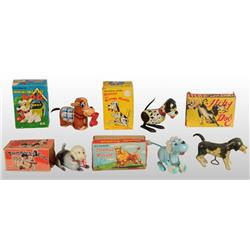Lot of 12: Dog Wind-Up Toys.