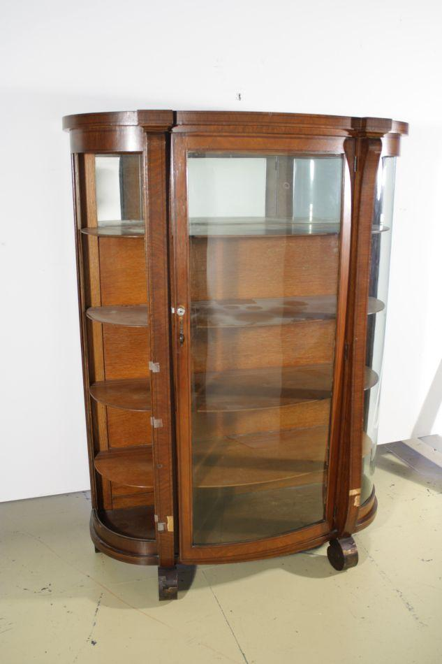An American Empire Style Oak Curio Cabinet. Loading Zoom