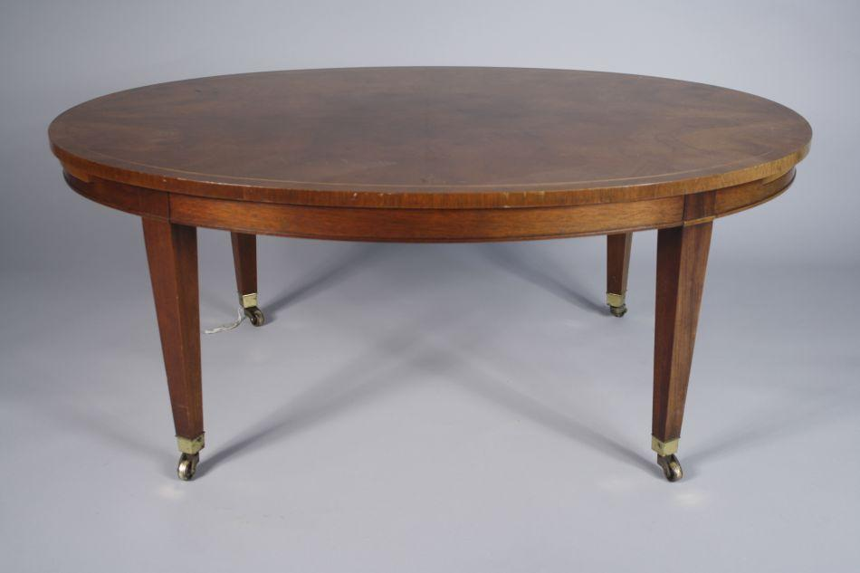 Image 1 : A Mahogany Baker Oval Coffee Table With Pullouts.