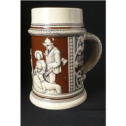 German stein with frog inside