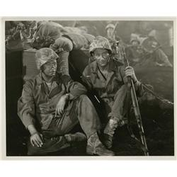 Collection of four vintage stills from The Sands of Iwo Jima and postcard signed by John Wayne