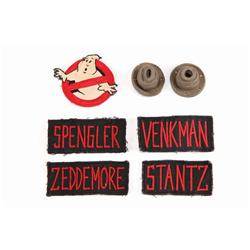Hero character name patches, Ghostbusters patch & 2 rubber jumpsuit nozzles from Ghostbusters