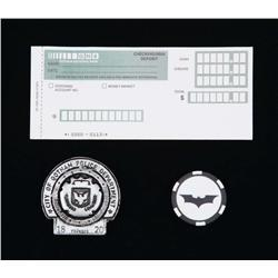 Gotham National Bank deposit slip, Police Dept. badge and souvenir Bat ship from The Dark Knight