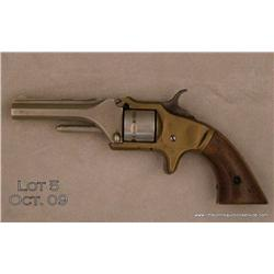 Manhattan Firearms Co. .22 cal. seven shot  revolver engraved, nickel plated, brass frame,  wood gri