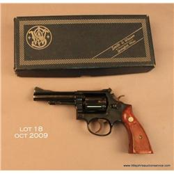 "Smith & Wesson Model 15-3 DA revolver, .38 S&W  Special, 4"" barrel, blue finish, checkered wood  med"