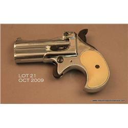 "RG O/U derringer, .22 Magnum cal., 3"" barrels,  nickel finish, checkered faux ivory grips, #9054.  T"