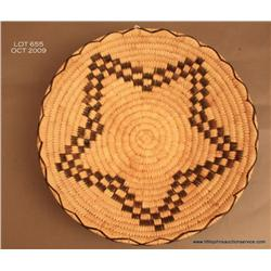 Papago 13 inch diameter basketry tray in squash  blossom design.  Excellent.  Estimate $125 - $250
